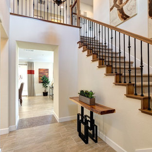 Inspiration for a mid-sized rustic laminate floor and beige floor entryway remodel in Sacramento with beige walls and a white front door