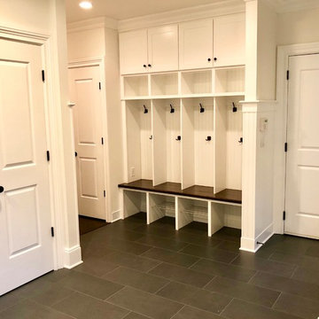 Porch Enclosed for Mudroom with Custom Bench and Cubbies.