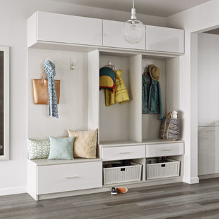 Design ideas for a contemporary boot room in Los Angeles with white walls, porcelain flooring and grey floors.