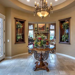 Idées déco pour un hall d'entrée classique de taille moyenne avec un mur beige, une porte double, une porte blanche, un sol en travertin et un sol beige.