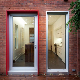 Inspiration for a contemporary single front door remodel in Ottawa with a glass front door