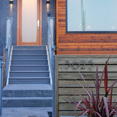 Inspiration for a contemporary entryway remodel in Vancouver with a glass front door