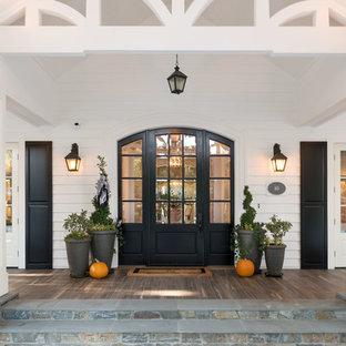 Rural front door in San Francisco with white walls, medium hardwood flooring, a single front door and a black front door.