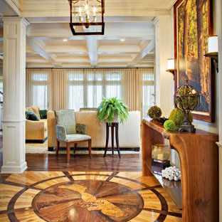 Large elegant medium tone wood floor foyer photo in Milwaukee with white walls