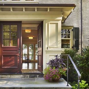 Inspiration for a timeless double front door remodel in Philadelphia with a red front door