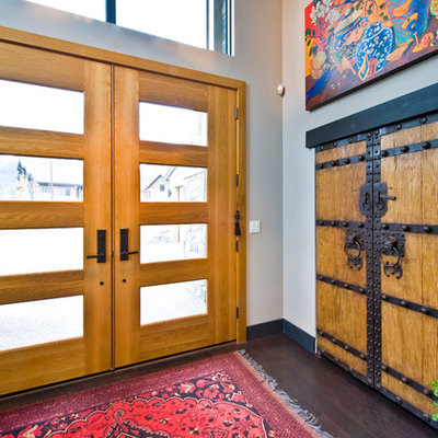 Inspiration for a contemporary entryway remodel in Calgary with a glass front door