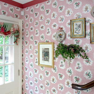 Small elegant porcelain tile and beige floor entryway photo with pink walls and a white front door