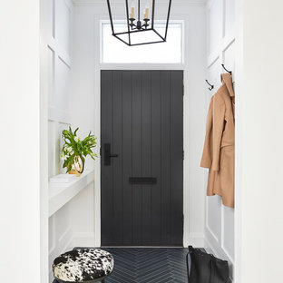 Example of a transitional blue floor entryway design in Toronto with white walls and a gray front door