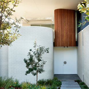 Contemporary entryway in Sydney with white walls, concrete floors, a single front door, a white front door and grey floor.