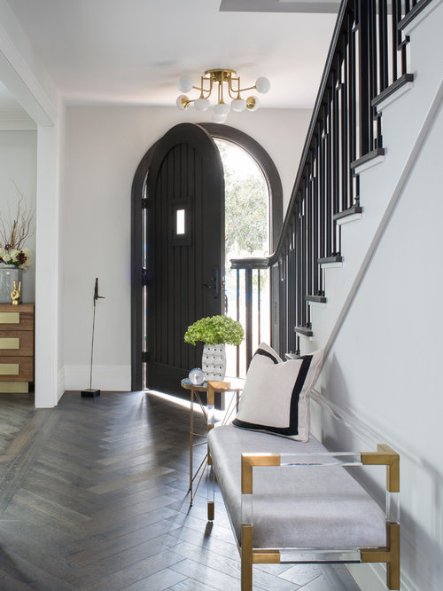 inspiration for a mid sized transitional medium tone wood floor and brown floor entryway remodel - Foyer Design Ideas