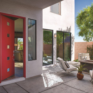 Entryway - contemporary entryway idea in Other with a red front door and gray walls