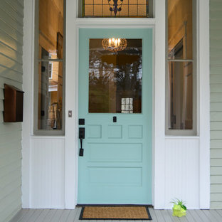 This is an example of a mid-sized victorian front door in Atlanta with a single front door and a blue front door.