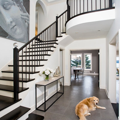 Inspiration for a timeless gray floor entryway remodel in Seattle with a black front door