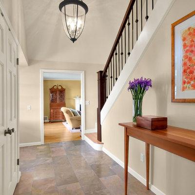 Elegant slate floor foyer photo in Seattle with beige walls