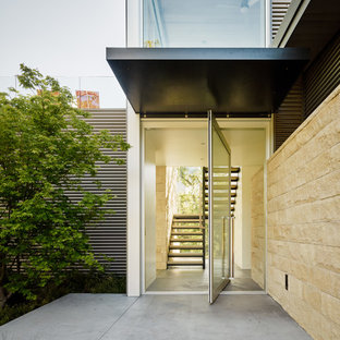 Example of a trendy entryway design in San Francisco with a glass front door