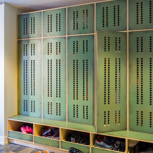 Example of a trendy multicolored floor mudroom design in Chicago with beige walls