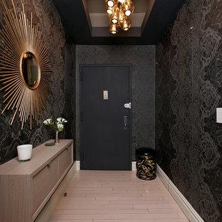 Trendy beige floor entryway photo in New York with black walls and a black front door