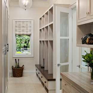 Example of a transitional granite floor mudroom design in San Francisco with white walls