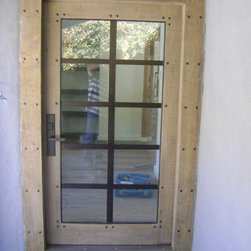 Reclaimed Wood Front Door - Reclaimed wood frame and entry door with metal framework insets.
