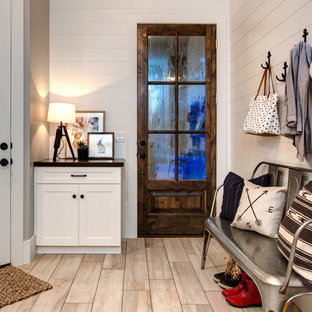 Inspiration for a large country porcelain floor single front door remodel in Salt Lake City with white walls and a white front door