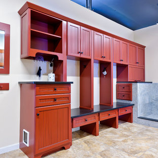 Red painted mudroom with granite benches