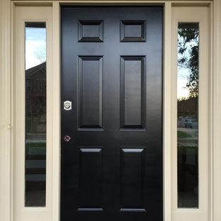 Inspiration för mellanstora moderna ingångspartier, med en enkeldörr och en svart dörr