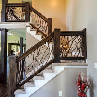 Example of a mid-sized mountain style dark wood floor entryway design in Kansas City with beige walls and a white front door
