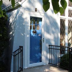 Replacement Entry Doors - Blue entry door with crab door knocker and white storm door.