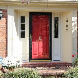 Replacement Entry Doors - Red entry door with pineapple door knocker, sidelights and black storm door.