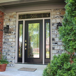Replacement Entry Doors - Black entry door with decorative sidelights and transom window.
