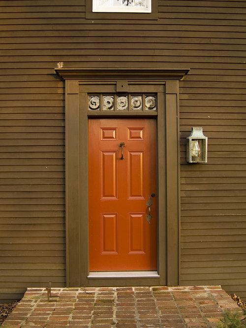 Ex&le of a classic entryway design in Cincinnati with a red front door & Workshop Doors | Houzz