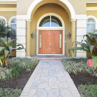 Example Of A Clic Entryway Design In Miami With Beige Walls And Medium Wood Front