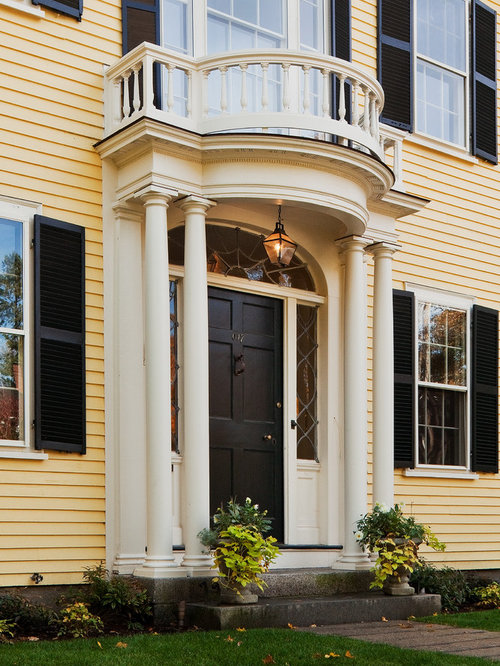Example Of A Large Classic Entryway Design In Boston With A Black Front Door  And Yellow