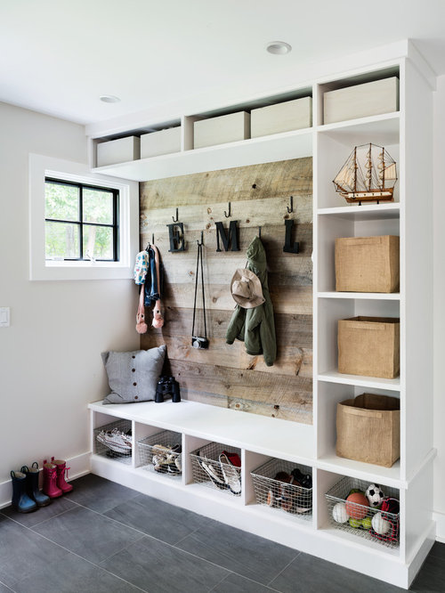 coastal gray floor mudroom photo in new york with beige walls - Mudroom Design Ideas