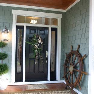 Elegant entryway photo in Raleigh with a black front door