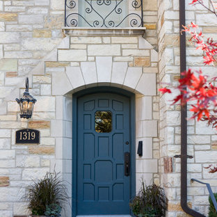 Inspiration for a large timeless gray floor entryway remodel in Chicago with beige walls and a blue front door