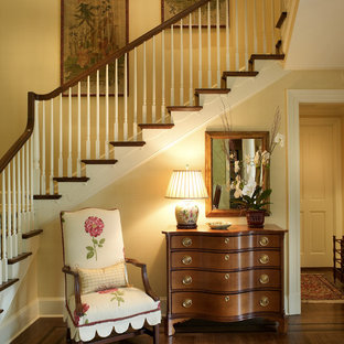 This is an example of a large foyer in Jacksonville with beige walls and dark hardwood floors.