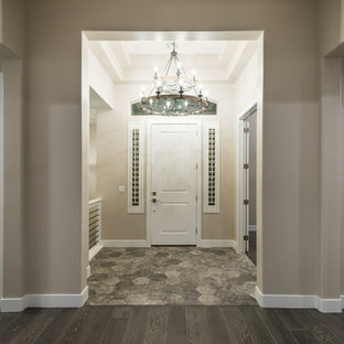 Transitional entryway photo in Salt Lake City with beige walls and a white front door