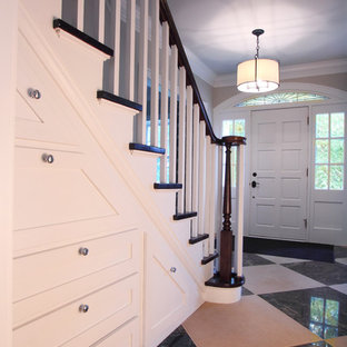 Inspiration for a mid-sized timeless limestone floor entryway remodel in Minneapolis with beige walls and a white front door