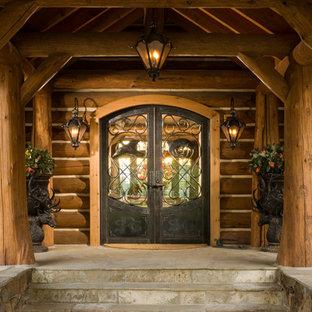 Mountain style slate floor double front door photo in Other with a metal front door