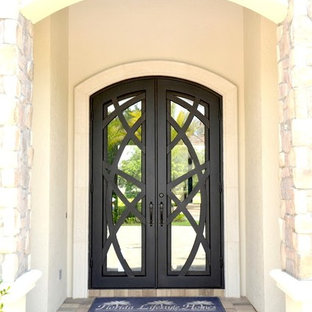 Large tuscan entryway photo in Tampa with a metal front door