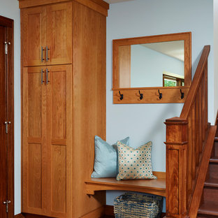 Inspiration for a transitional dark wood floor mudroom remodel with blue walls