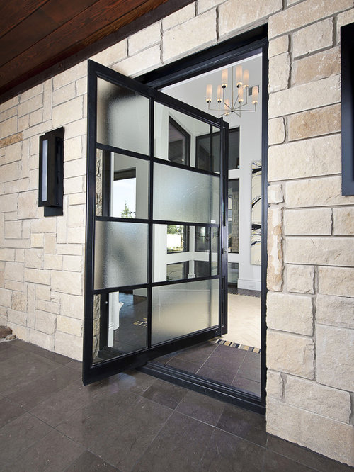 Inspiration for a contemporary pivot front door remodel in Austin with a glass front door & Nano Wall Doors | Houzz