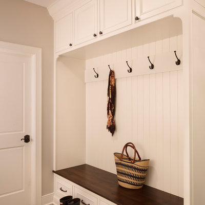Entryway - mid-sized cottage ceramic tile and beige floor entryway idea in Milwaukee with beige walls and a white front door