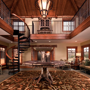 Inspiration for a rustic granite floor foyer remodel in Other with beige walls