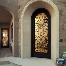 Mediterranean Entry by Tommy Chambers Interiors, Inc.