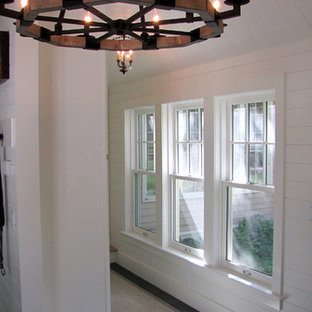 Entryway - large rustic black floor and granite floor entryway idea in Boston with white walls and a green front door