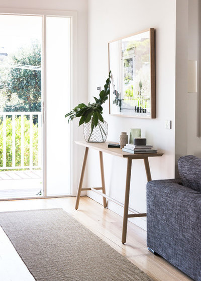 Beach Style Entry by The Den Interiors