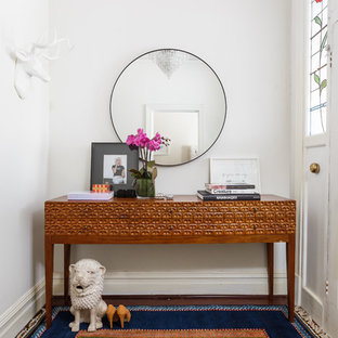 Inspiration for an eclectic multicolored floor entry hall remodel in Perth with white walls and a white front door