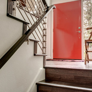 Inspiration for a contemporary vestibule in Seattle with white walls, medium hardwood flooring, a single front door and a red front door.